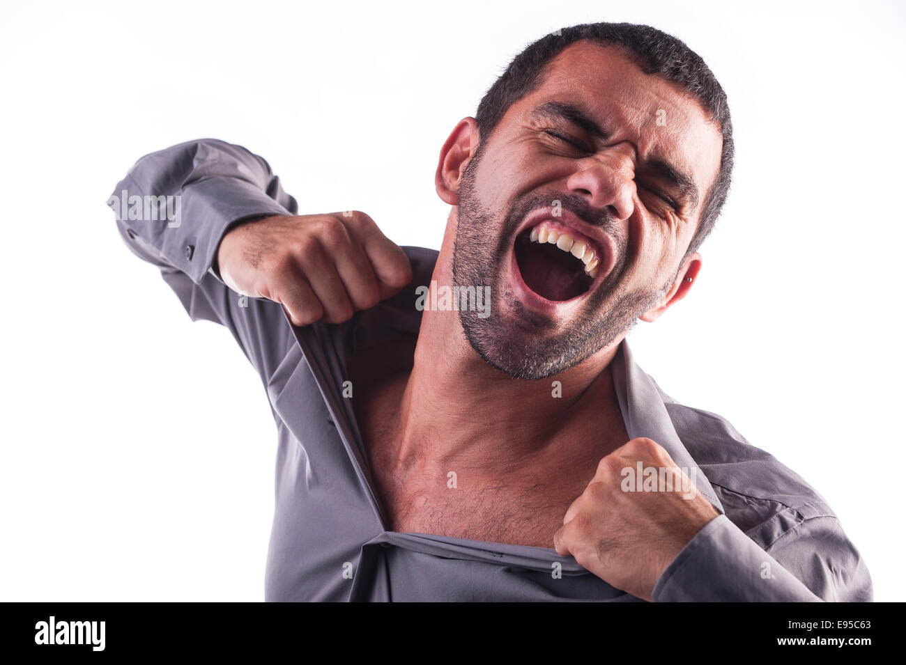 man screaming and ripping his shirt - Stock Image