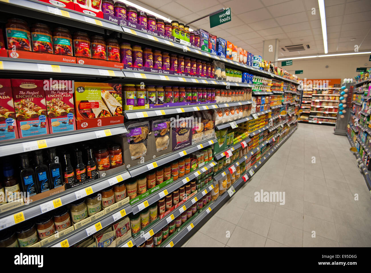 Supermarket world foods aisle with shelves packed full - Stock Image