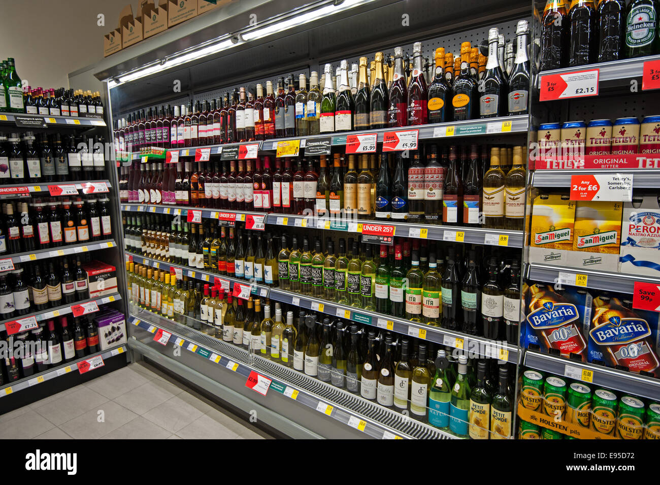 Supermarket shelves filled with alcohol - Stock Image