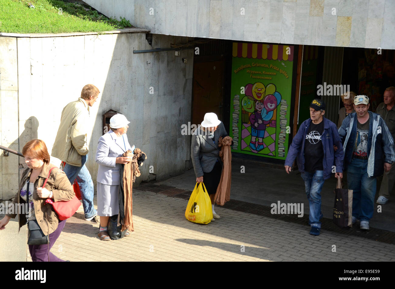 latvian women selling tights in underpass near riga market latvia - Stock Image