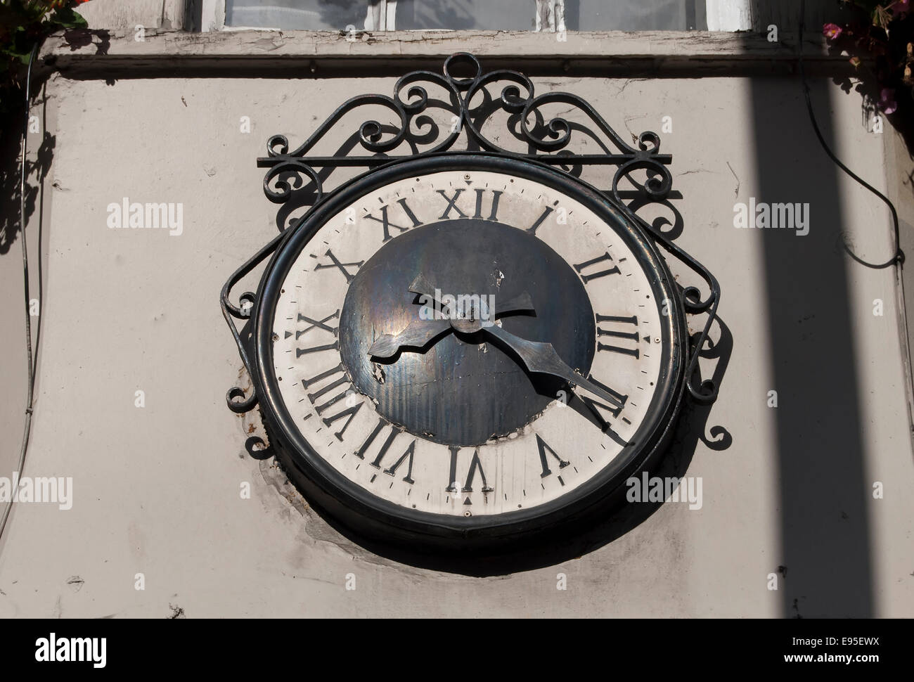 roman numeral clockface on exterior of the george public house, twickenham, middlesex, england - Stock Image
