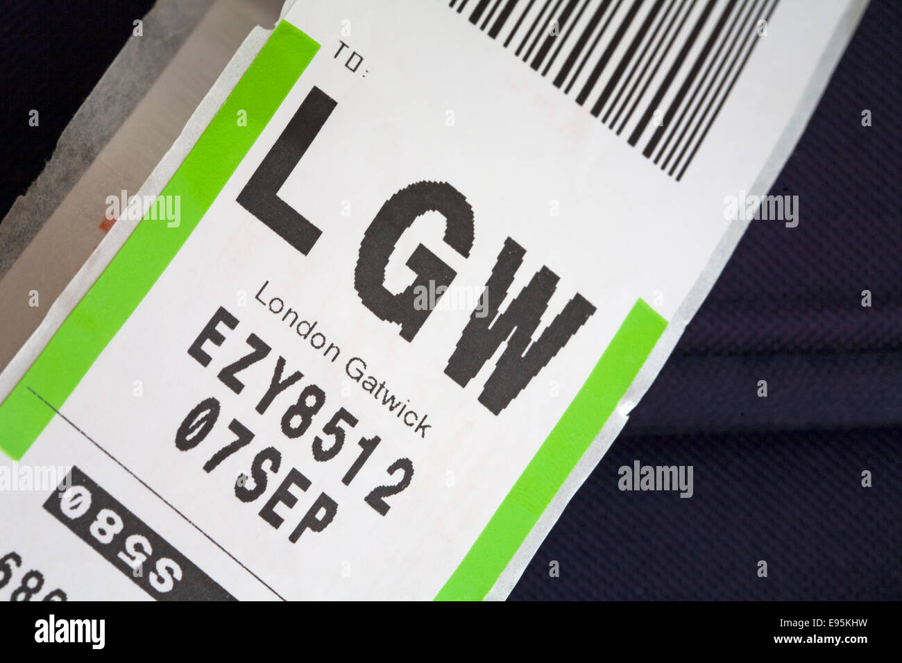 luggage label stuck on bag for LGW London Gatwick airport - Stock Image