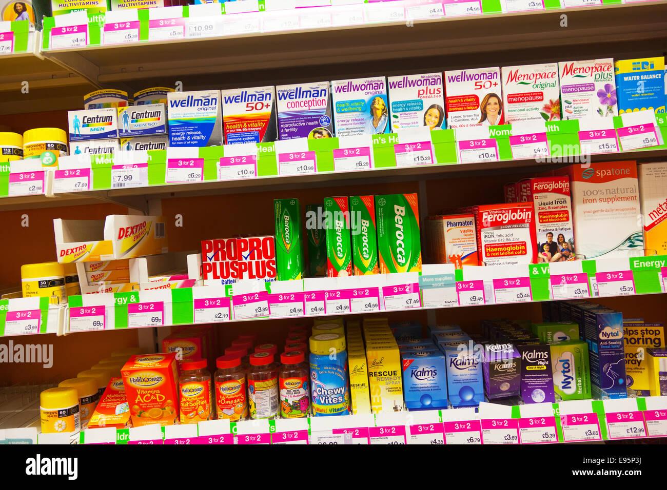 Wellman berocca vitamins health vitality product products on shelf at chemist Chemists shop store inside display - Stock Image