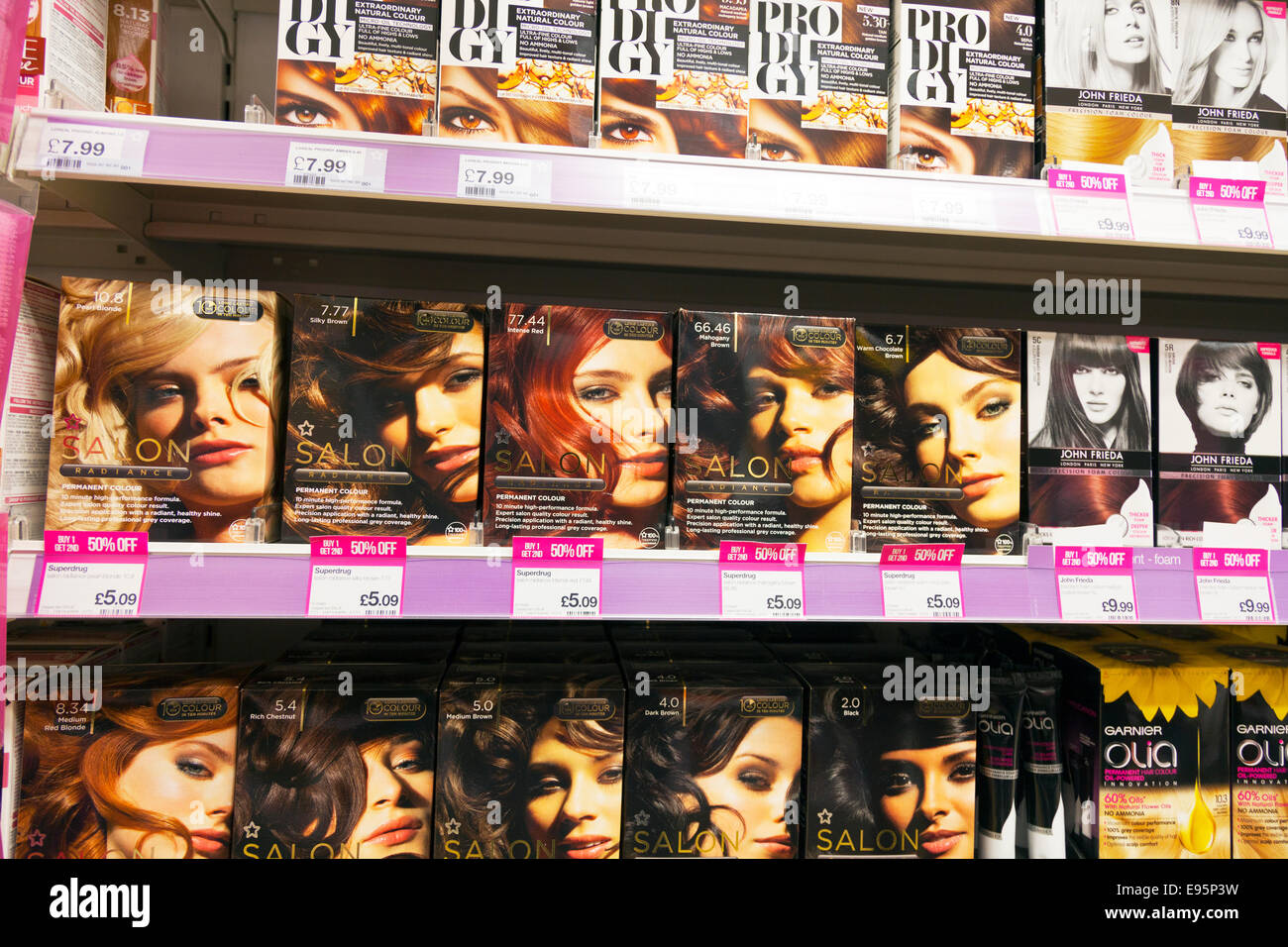 Salon hair dye boxes John Frieda product products on shelf at chemist Chemists shop store - Stock Image