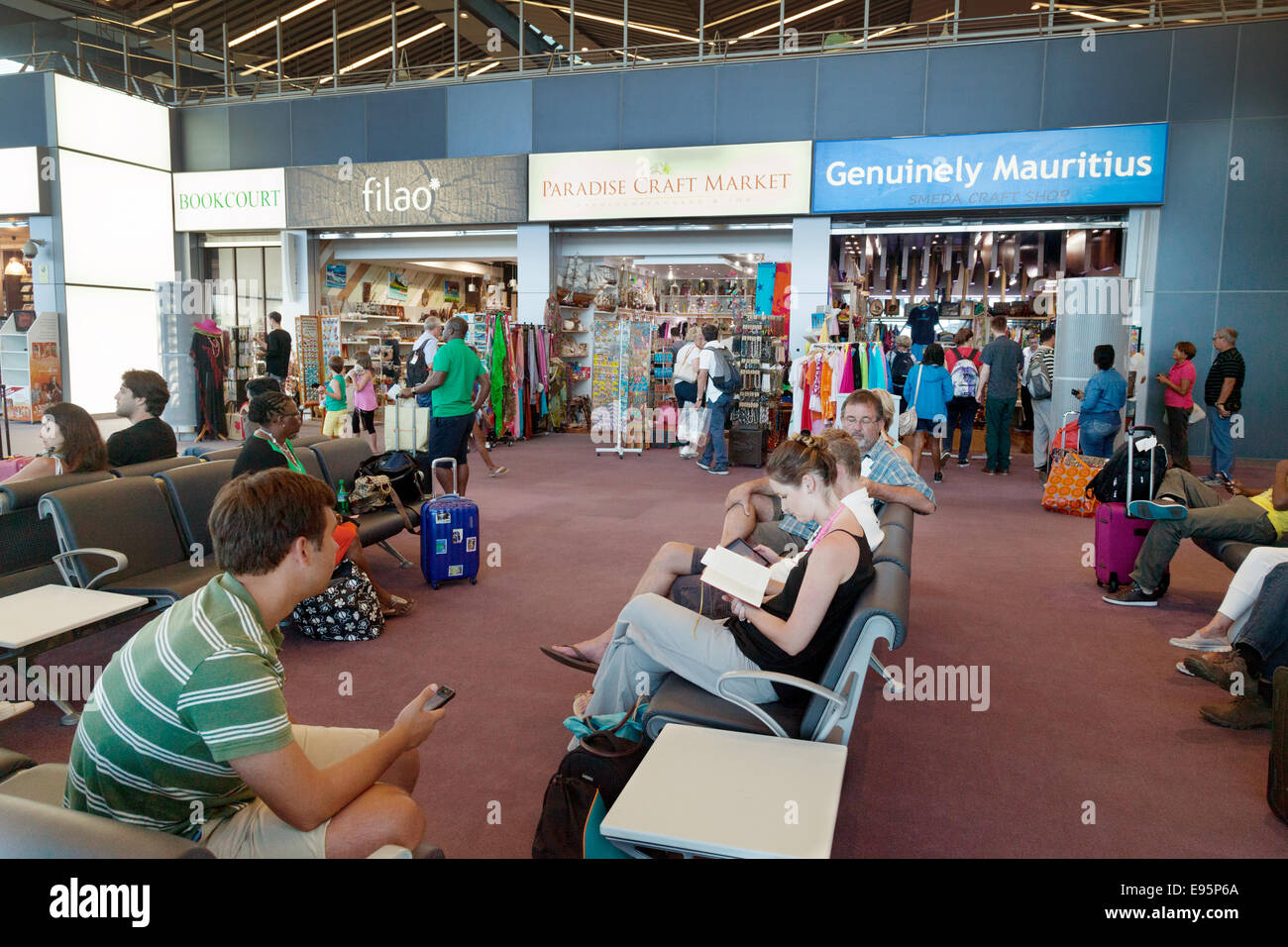 People sitting in the Departure lounge in the terminal, Mauritius airport, Africa - Stock Image