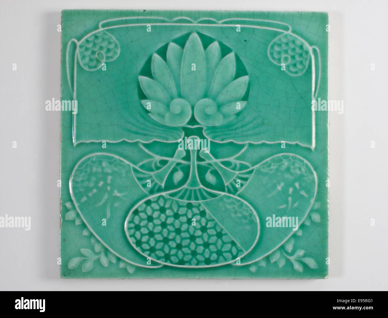 Pilkington Royal Lancastrian Aesthetic Movement tile, decorated with a Japanese inspired design of fans and a large - Stock Image
