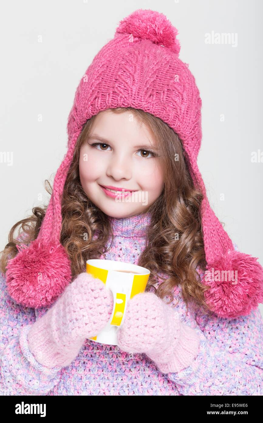 happy little child in winter clothes and hot chocolate, cute baby