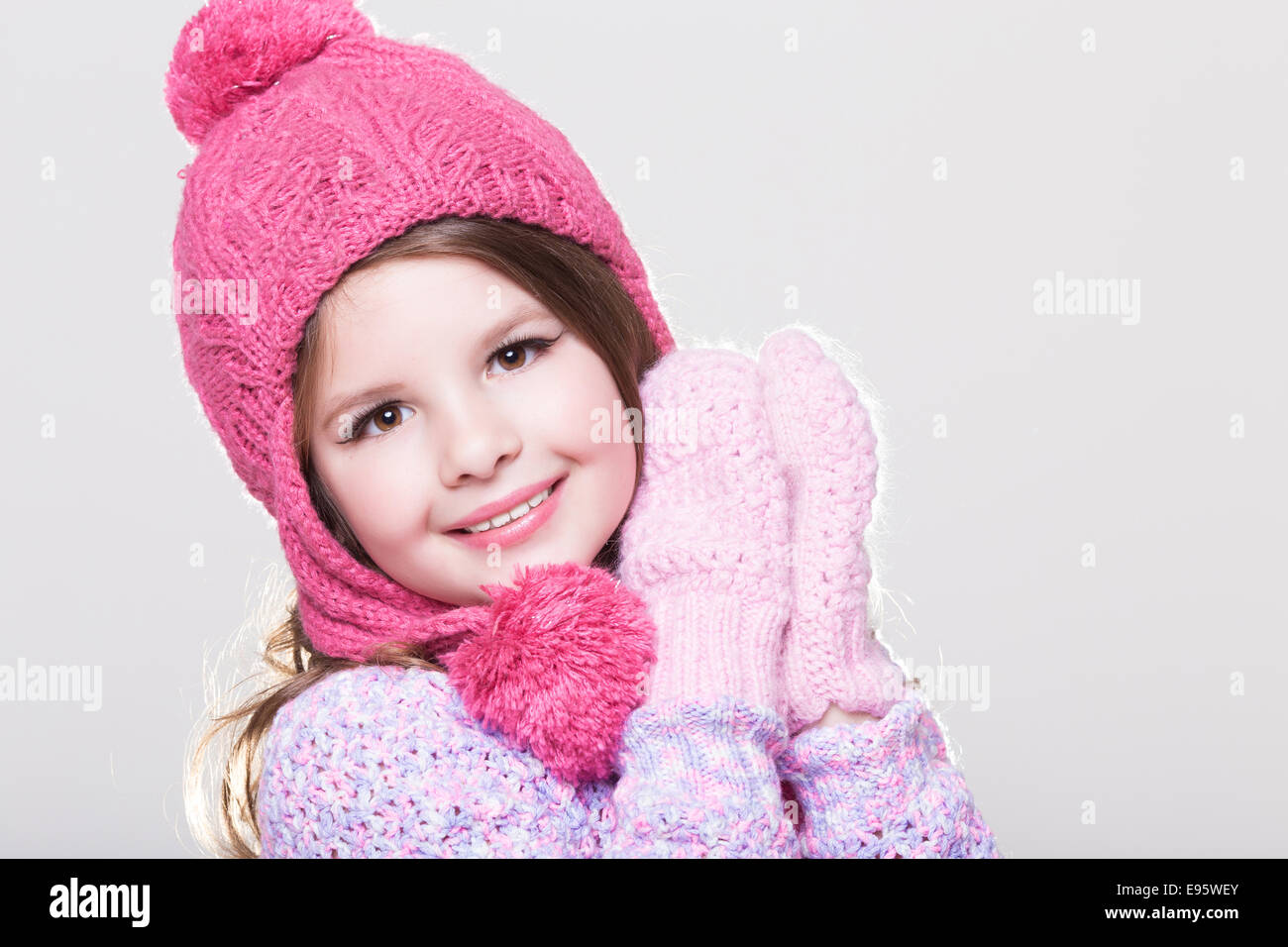 happy little child in winter clothes, cute baby girl in woolen stock