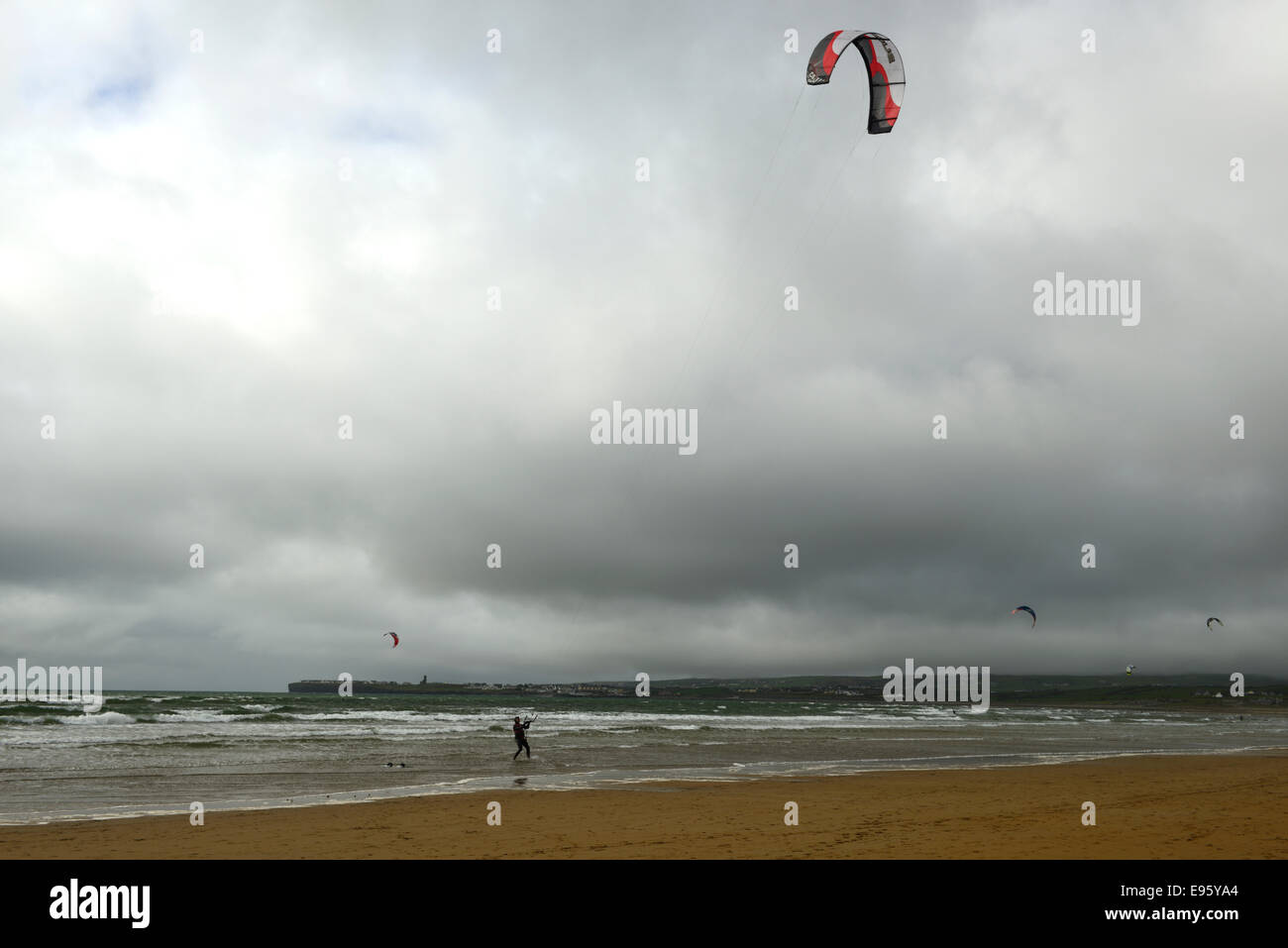 kite surf surfing surfer lahinch lehinch clare ireland west coast wild atlantic stormy day - Stock Image