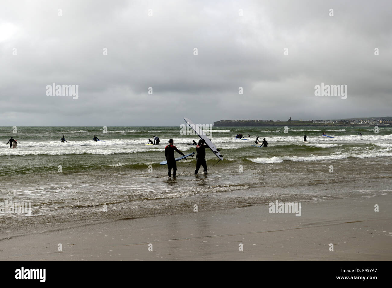 surf surfing surfer lahinch lehinch clare ireland west coast wild atlantic stormy day - Stock Image