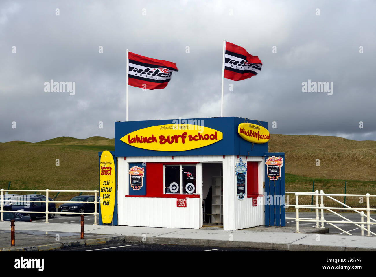 surf school shop hut shack shed lahinch lehinch clare ireland surfing surfer learn teach teaching stormy day - Stock Image