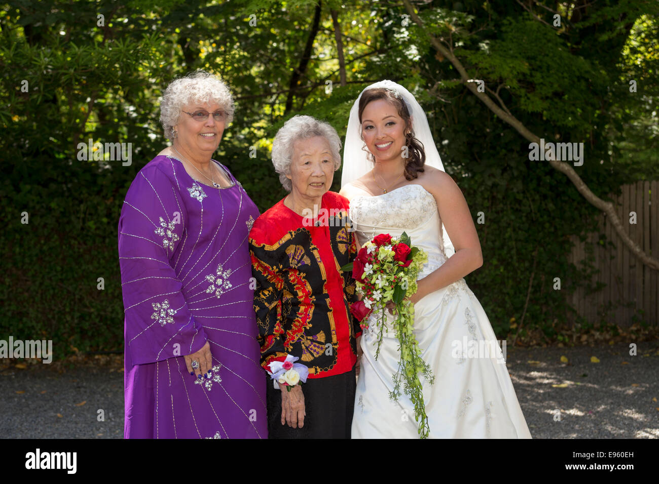 3 three generations, bride with mother and grandmother wedding party wedding at Marin Art and Garden Center in Ross - Stock Image