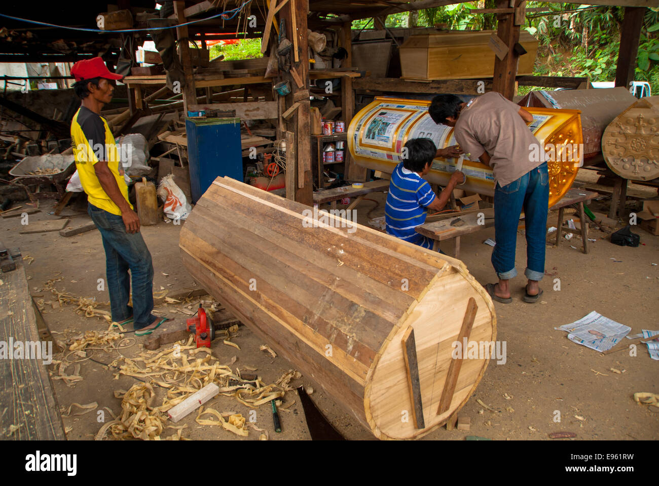 carpenter works at coffins at kete kesu in sulawesi in indonesia - Stock Image