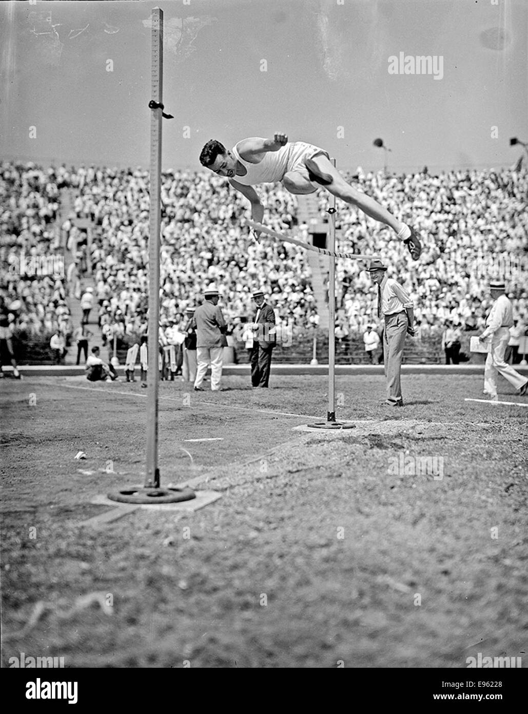 [Athlete knocking down the high jump bar at the 1936 Randall's Island Olympic trials, New York, NY] - Stock Image