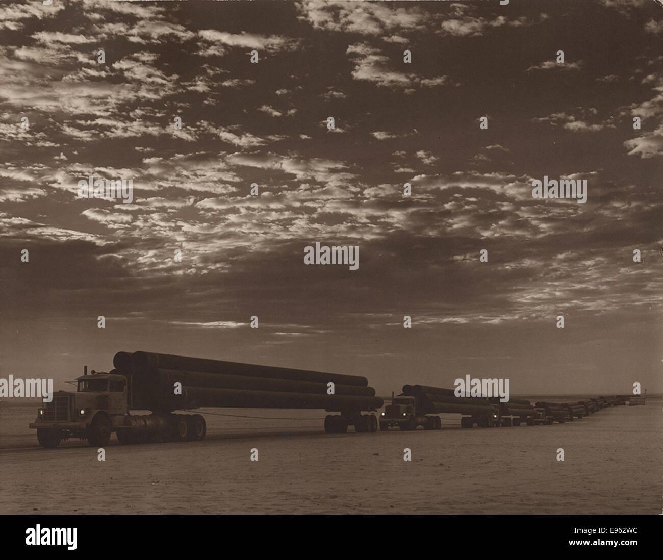 Trucks loaded with line pipe, Arabian American Oil Co