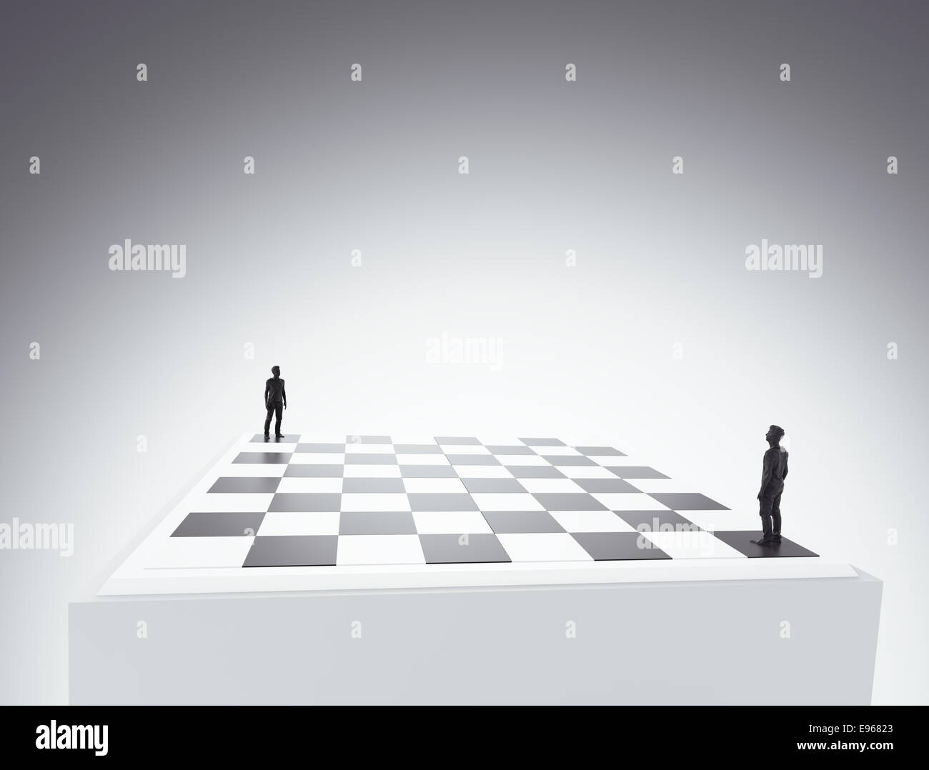 Two tiny figures standing on a chess board - conflict and competition concept illustration - Stock Image