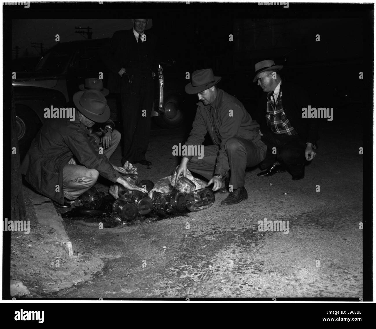 Federal Officers Dumping Whiskey, Crystal Springs, 1-15-1951 12613916024 o Stock Photo