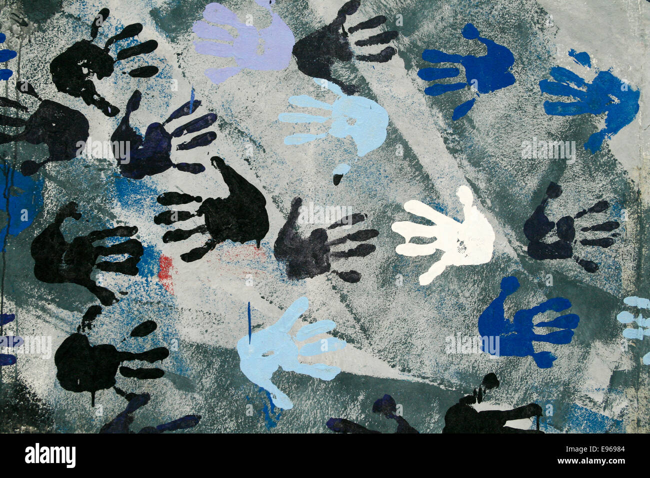 Section of painting with handprints at East Side Gallery, Berlin Wall, Berlin, Germany.  'Touch the Wall' - Stock Image