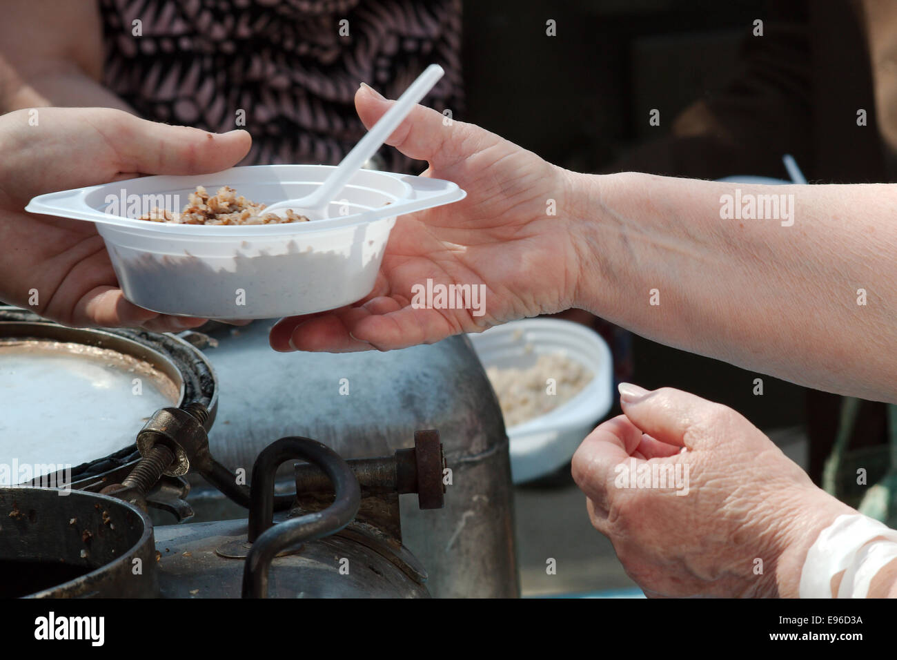 Charitable distribution of meal - Stock Image