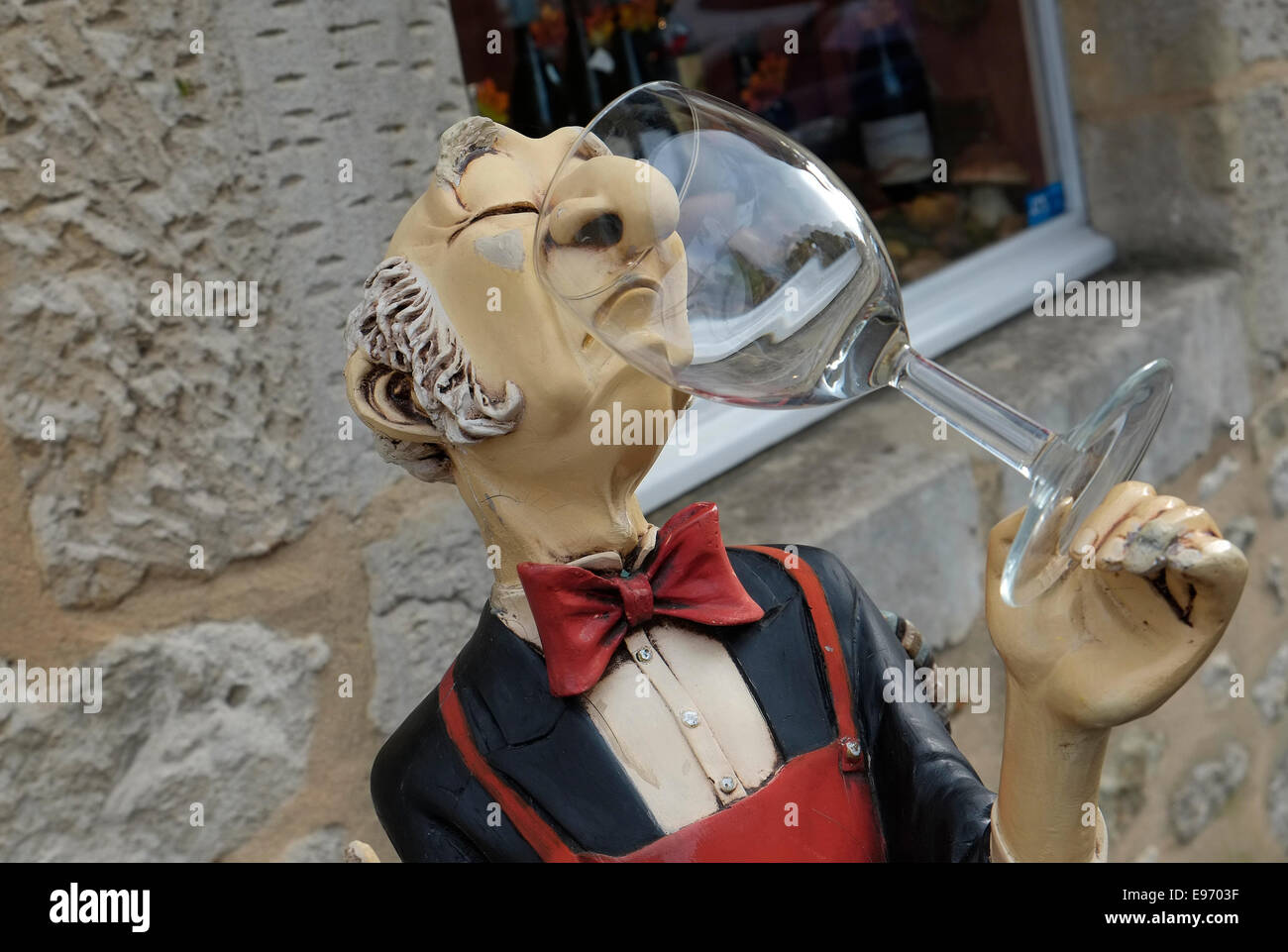 snooty french wine waiter holding glass - Stock Image