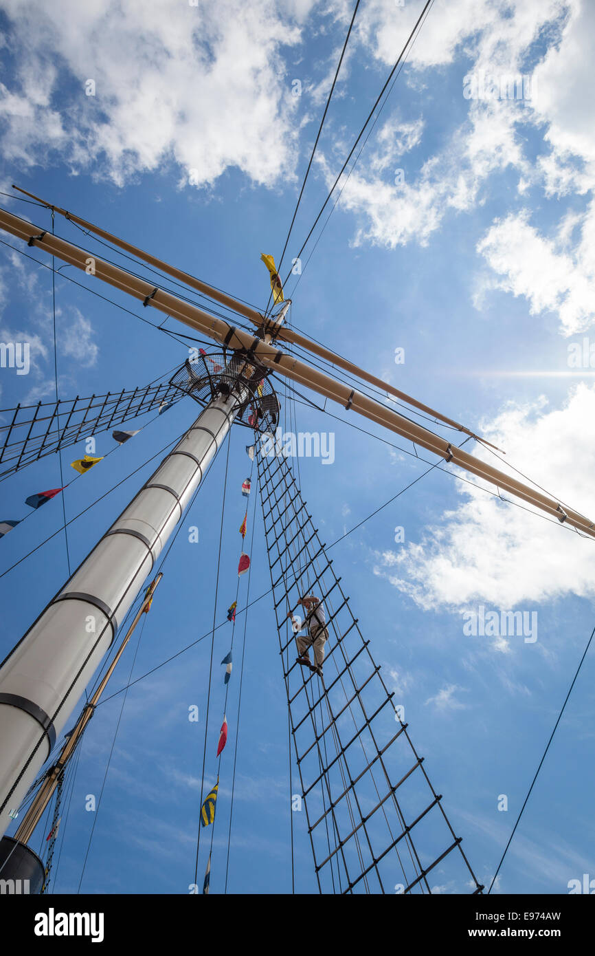 An older man climbs the rigging on Isambard Kingdom Brunel's SS Great Britain as part of a tourist attraction - Stock Image