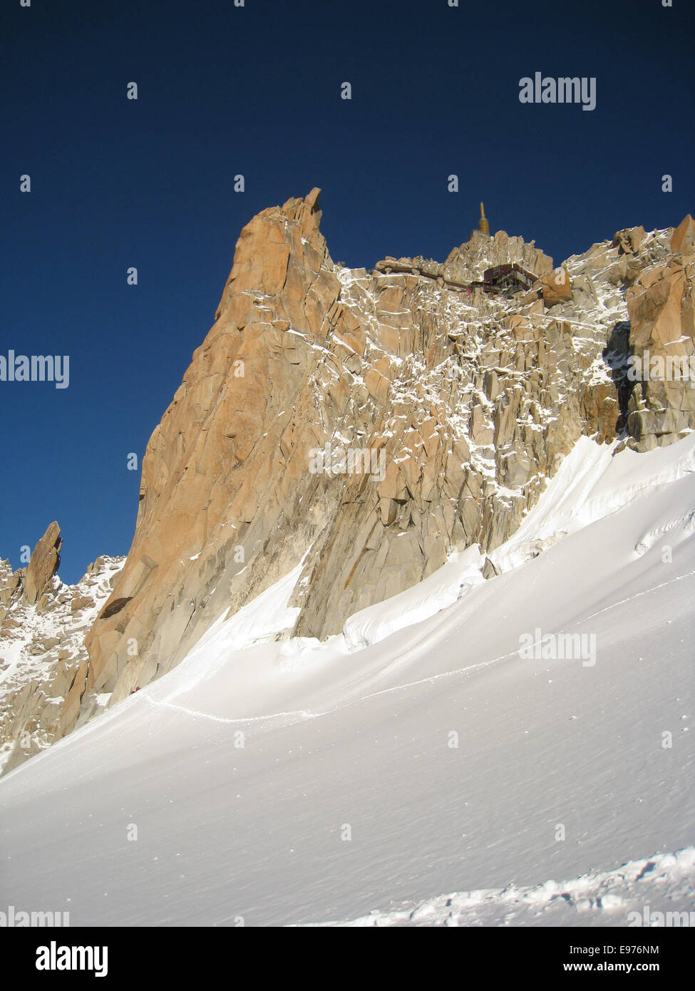 Rock wall underneath the Aiguille du Midi above Chamonix - Stock Image