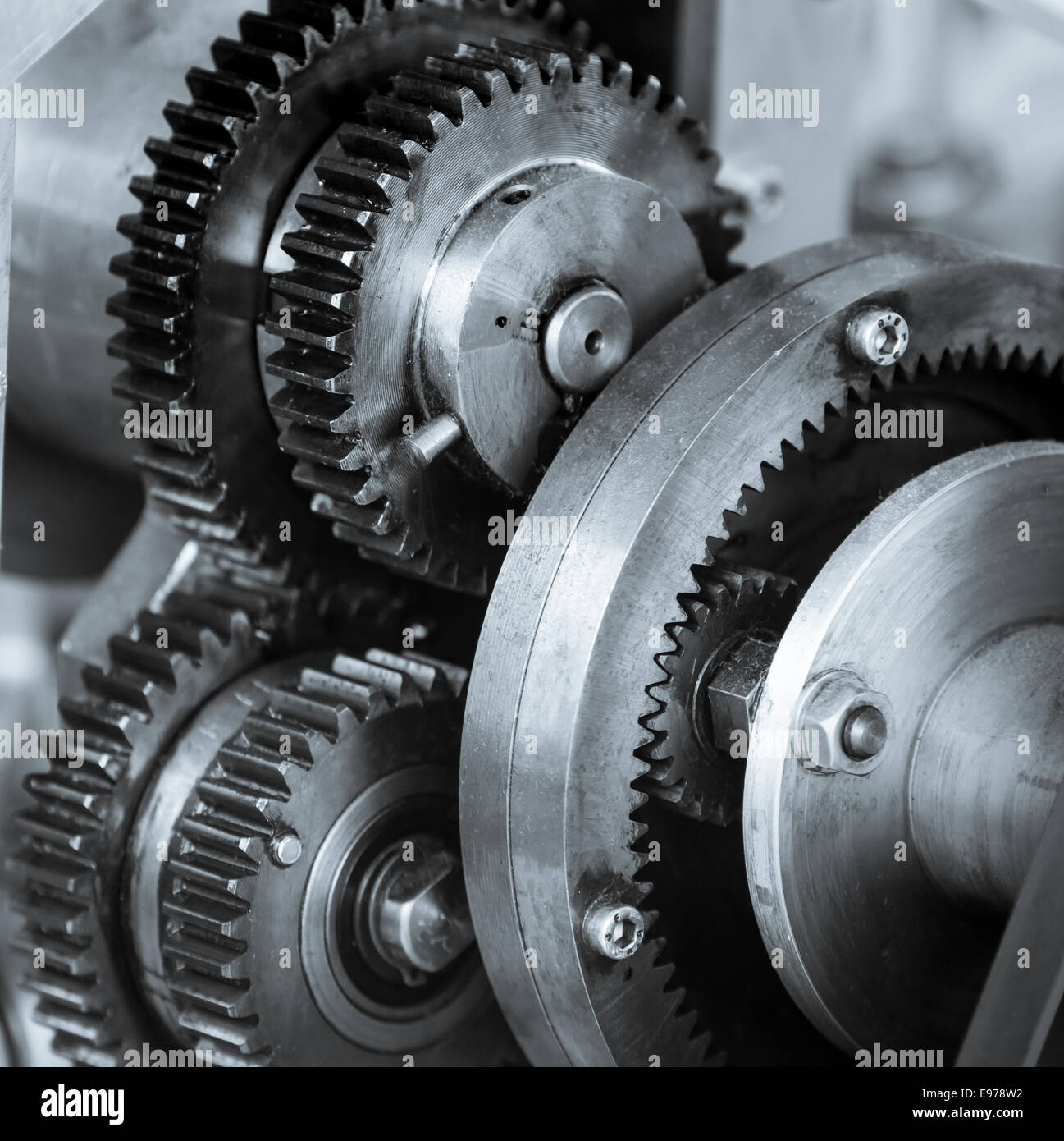 Gears and cogs of old machine - Stock Image