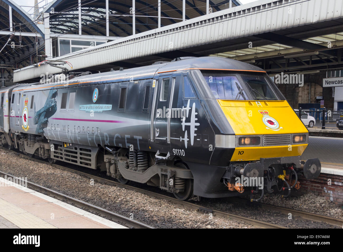 East Coast Class 91 electric locomotive 91110 'Battle  of Britain Memorial Flight' standing at Newcastle - Stock Image