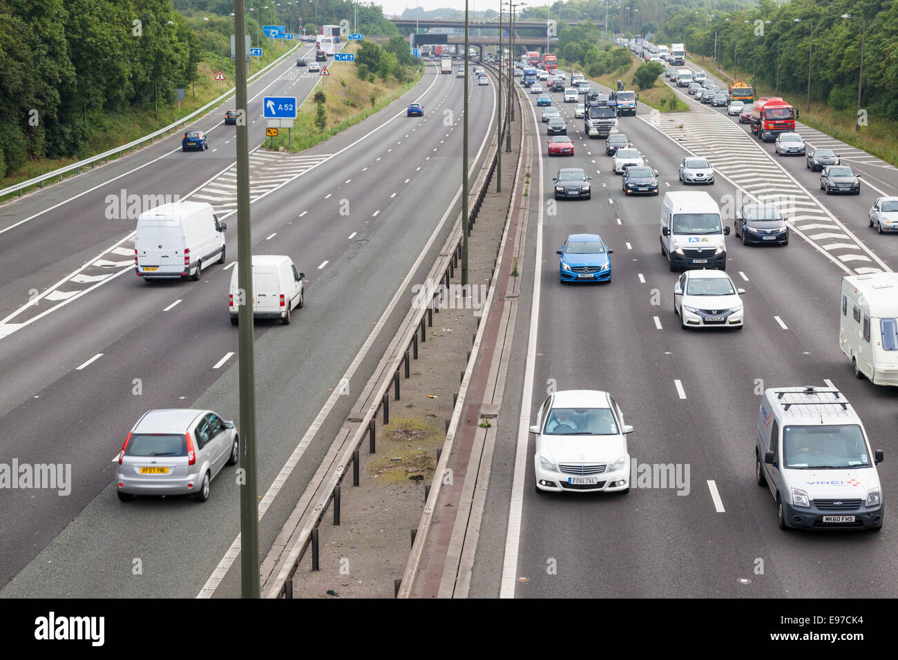 Traffic congestion with slow moving traffic and a long tailback of vehicles, Junction 25 M1 motorway, Nottinghamshire - Stock Image