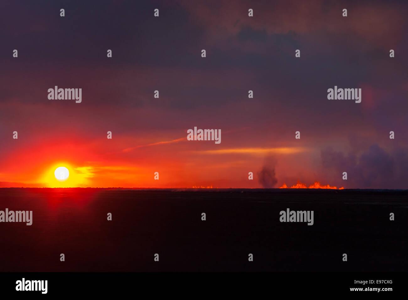 sun rise over the eruption at Holuhraun - Stock Image
