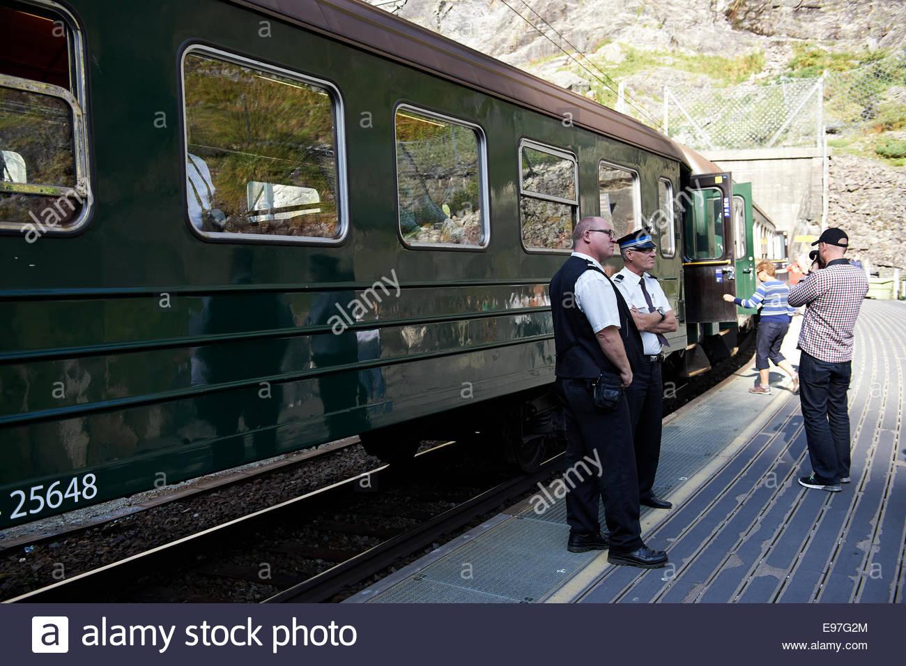 Train, Tourists and Railway Officials at the Kjosfossen Waterfall Platform of the Flamsbana Railway, Flam, Aurlandsfjord, - Stock Image