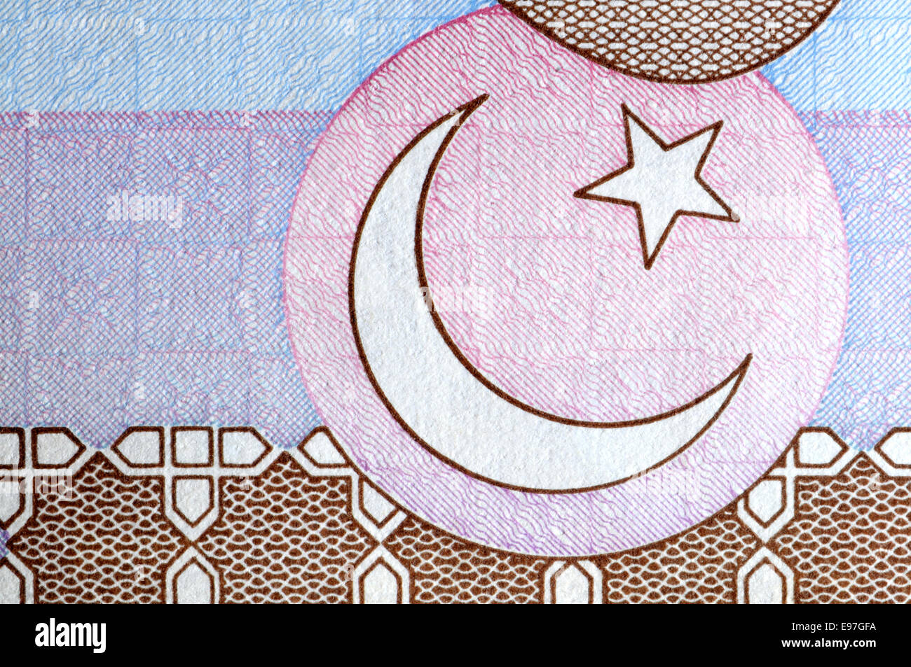 Detail from a Pakistan banknote showing the crescent moon and a star - Stock Image