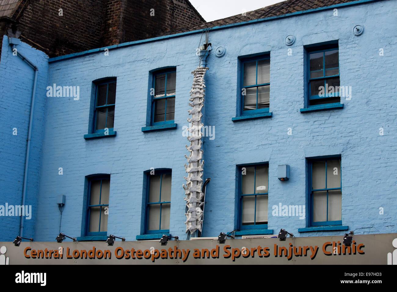 osteopahty backbone drainpipe weird shop amazing - Stock Image