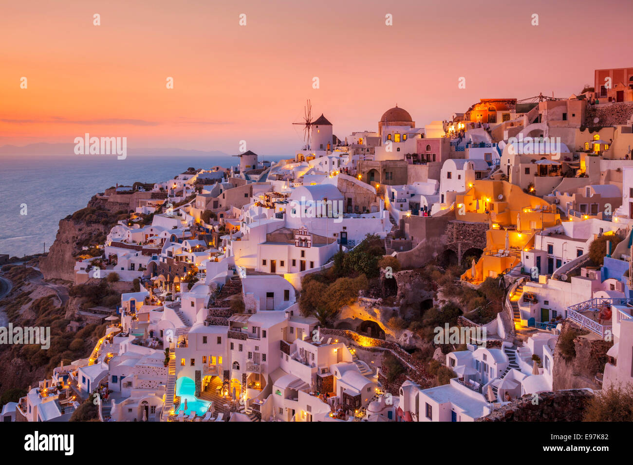 Windmill & white houses at sunset  in the village of Oia, Santorini, Thira, Cyclades Islands, Greek Islands, Greece, Stock Photo