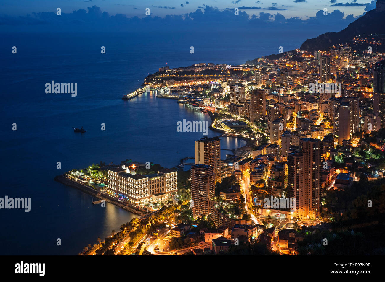 Aerial view over the city and port of Monte Carlo, Monaco along the French Riviera at night, Côte d'Azur - Stock Image