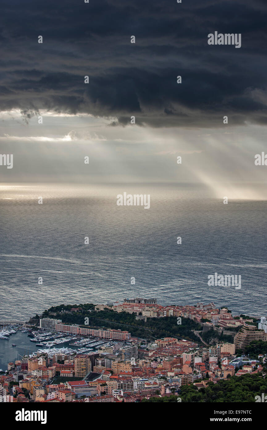 Aerial view over the city and port of Monte Carlo, Monaco and dark menacing rain clouds over the sea along the French Stock Photo