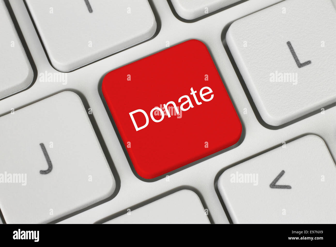 Red donate button on the keyboard close-up - Stock Image