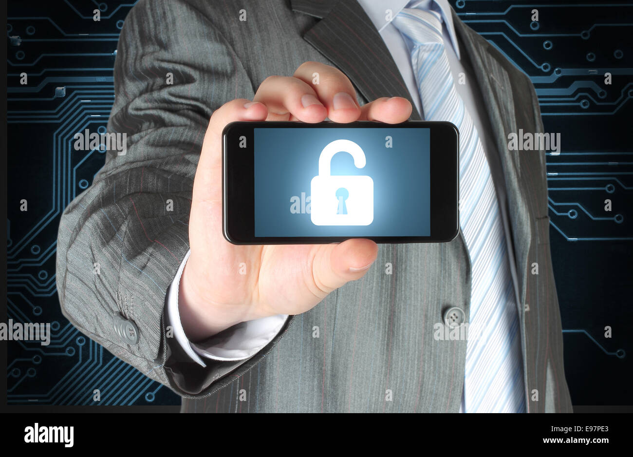 Businessman holds smart phone with open lock on white background, security concept - Stock Image