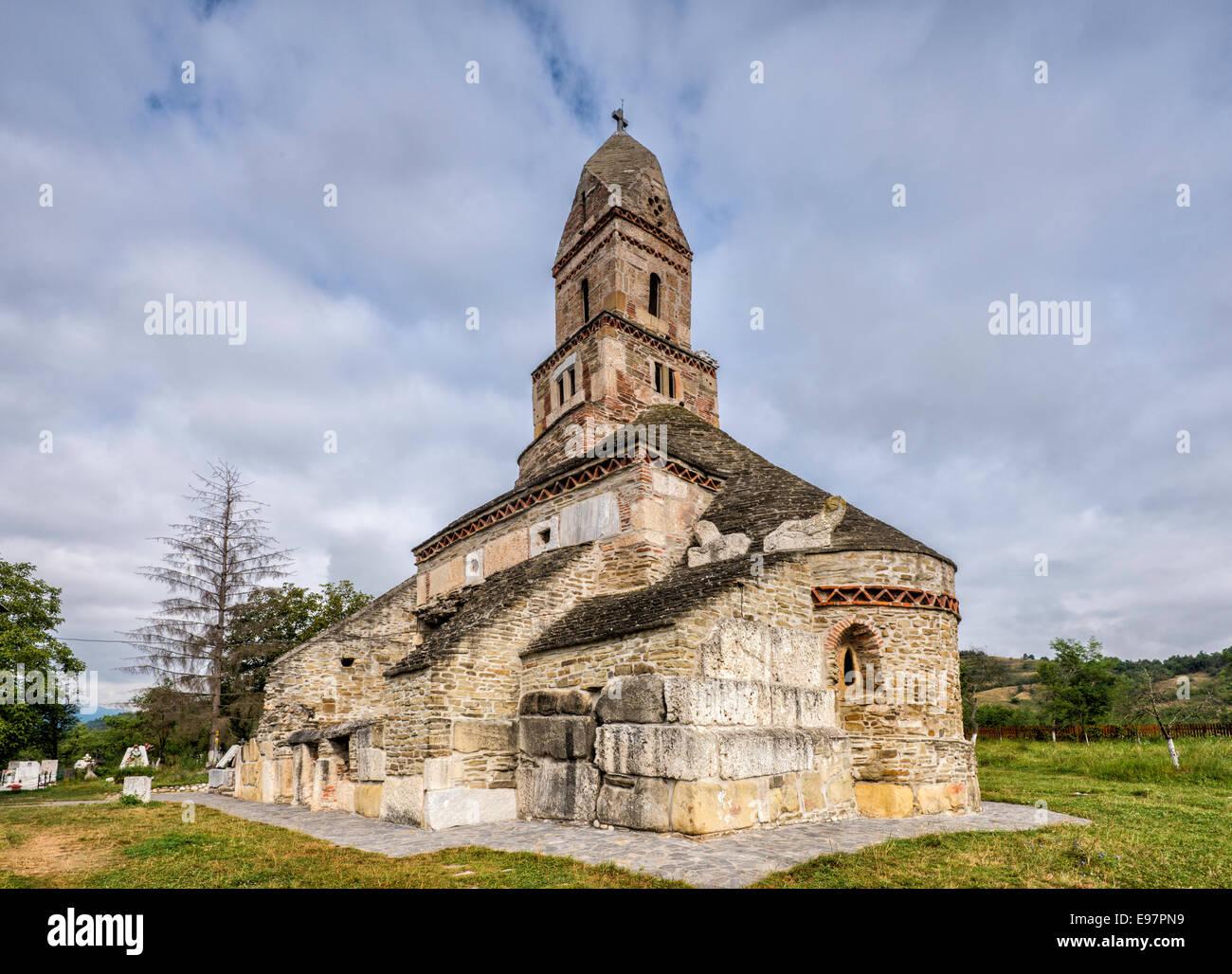 Biserica Sf Nicolae, medieval Orthodox Church of St Nicholas, 7th century, in village of Densus, Transylvania, Romania - Stock Image