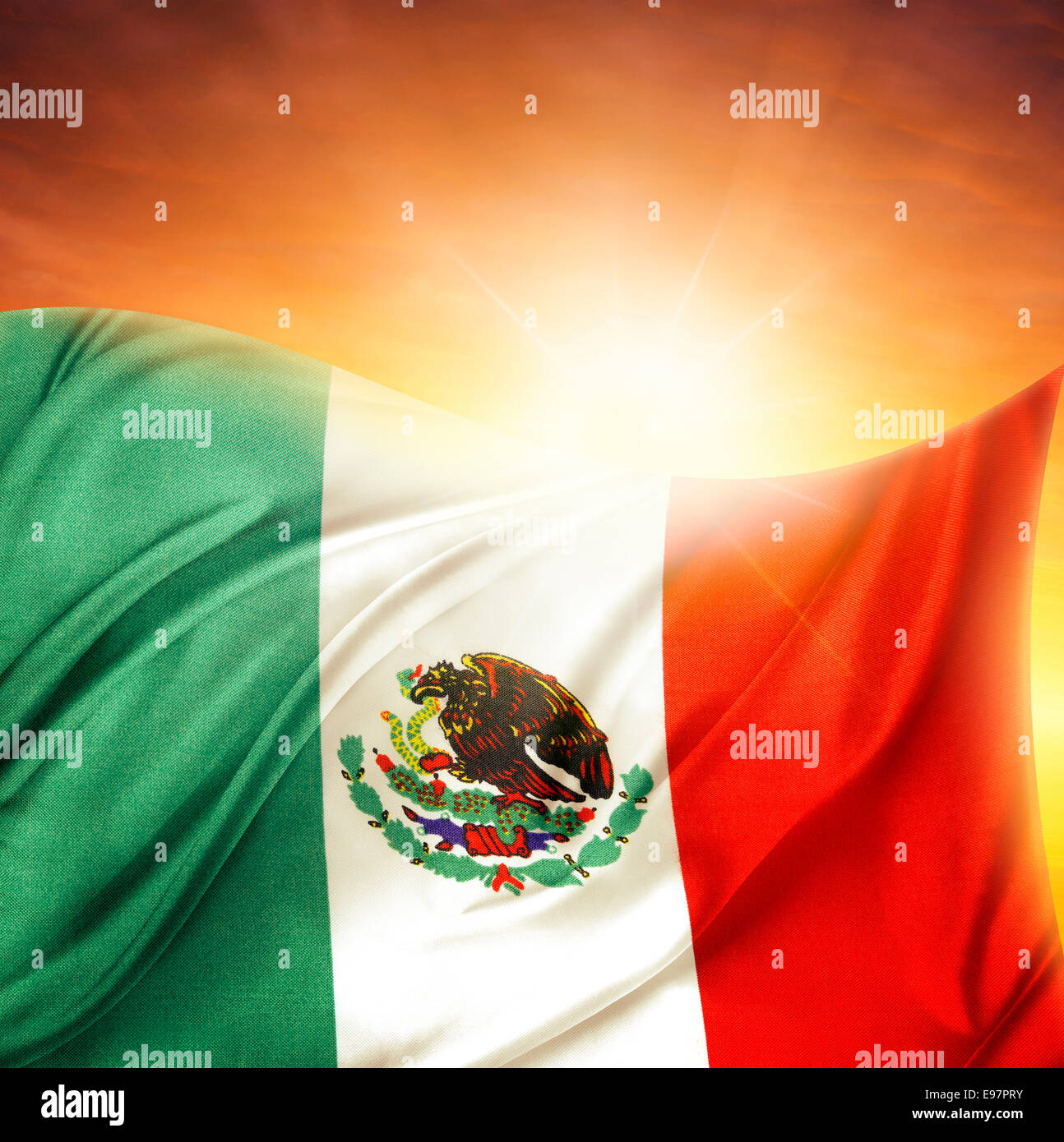Mexican flag in front of bright sky - Stock Image