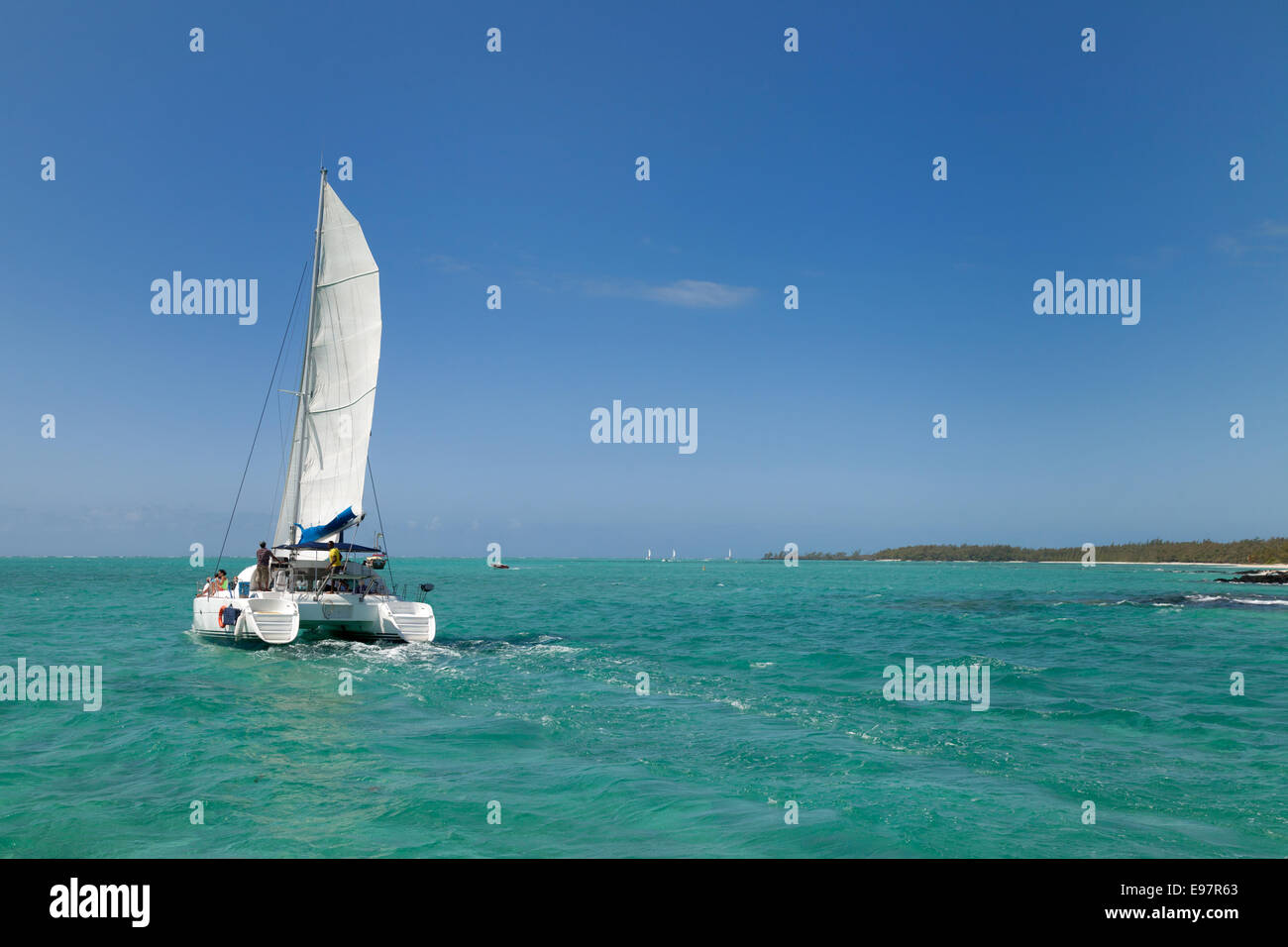 A catamaran sailing in the Indian Ocean off the coast of Mauritius - Stock Image
