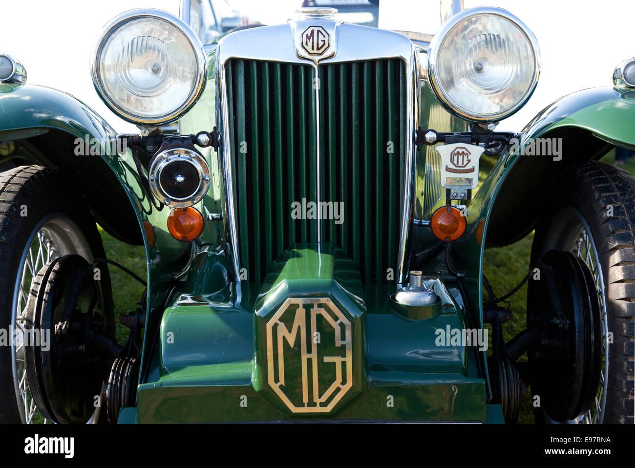 A green vintage MG motor vehicle - Stock Image