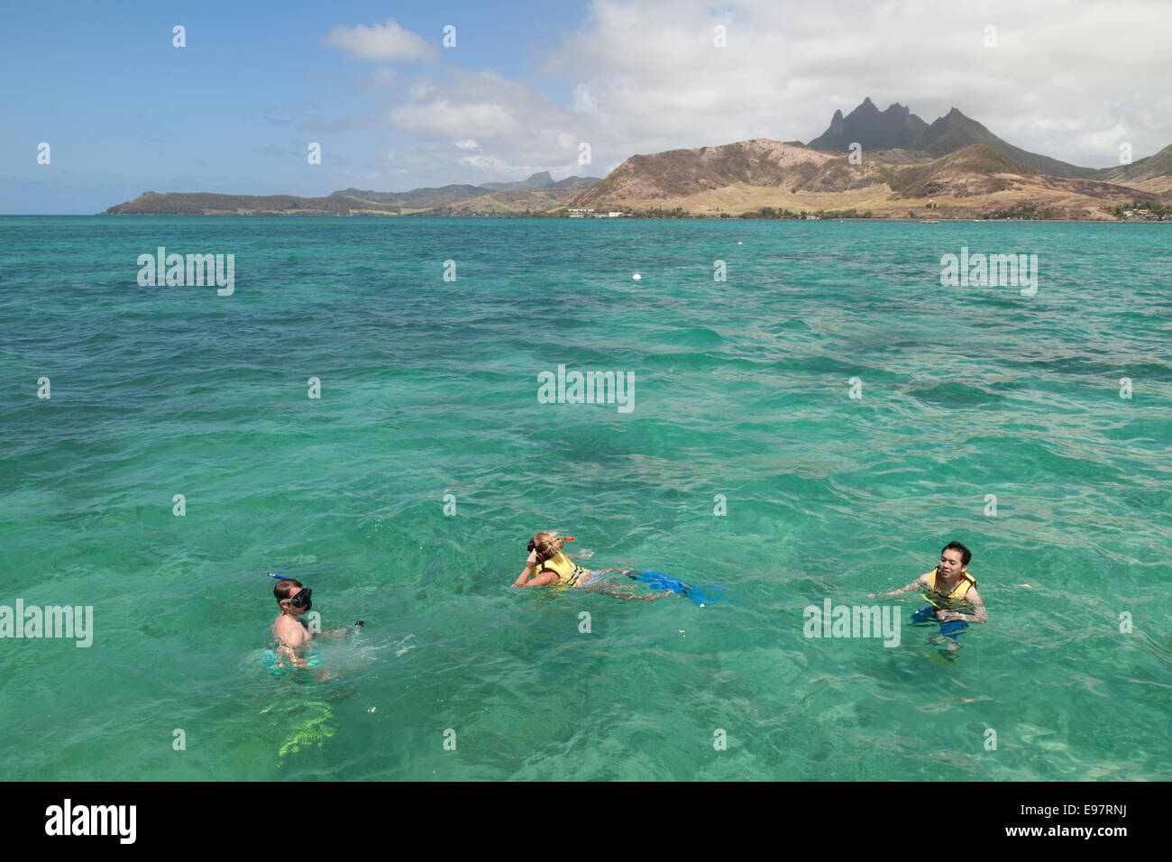 People snorkeling in the Indian Ocean, Mauritius - Stock Image