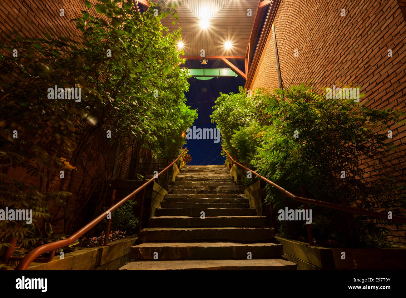 The Wallis Mill Laneway Stairs looking up towards Maple Street in downtown Port Carling at dusk. Ontario, Canada. - Stock Image