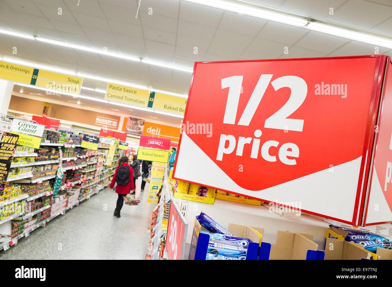Half price sign in Morrisons supermarket, London, England, UK - Stock Image