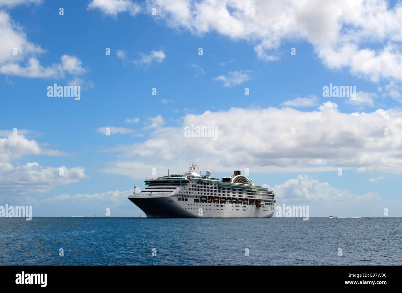 A cruise ship in the sea under the clouds. - Stock Image
