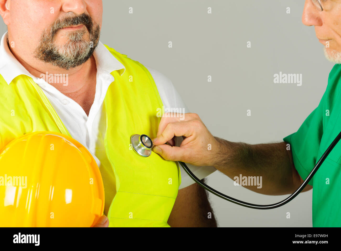 hard hat labor at medical doctor examination isolated background - Stock Image