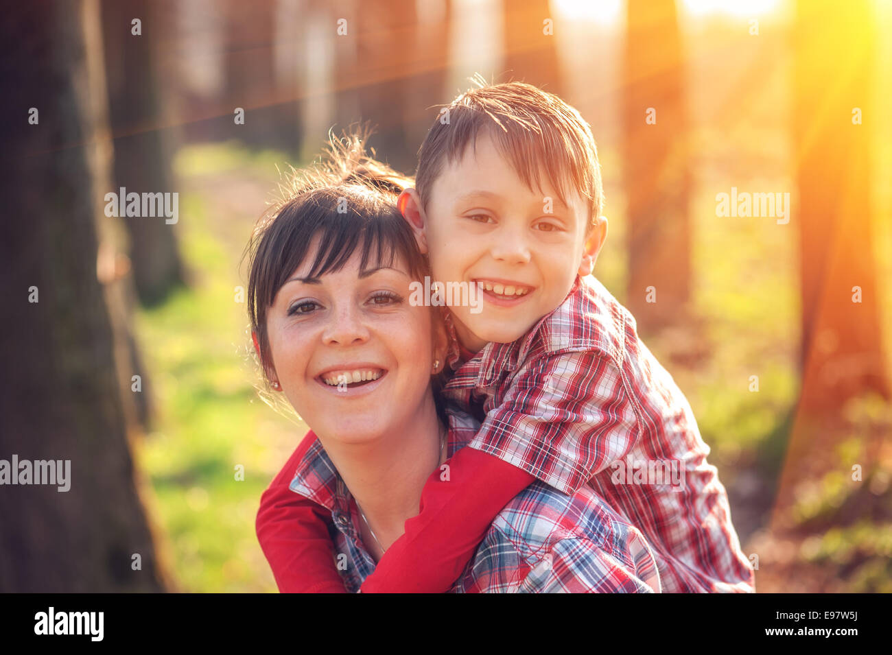 boy and mom have fun on park - Stock Image