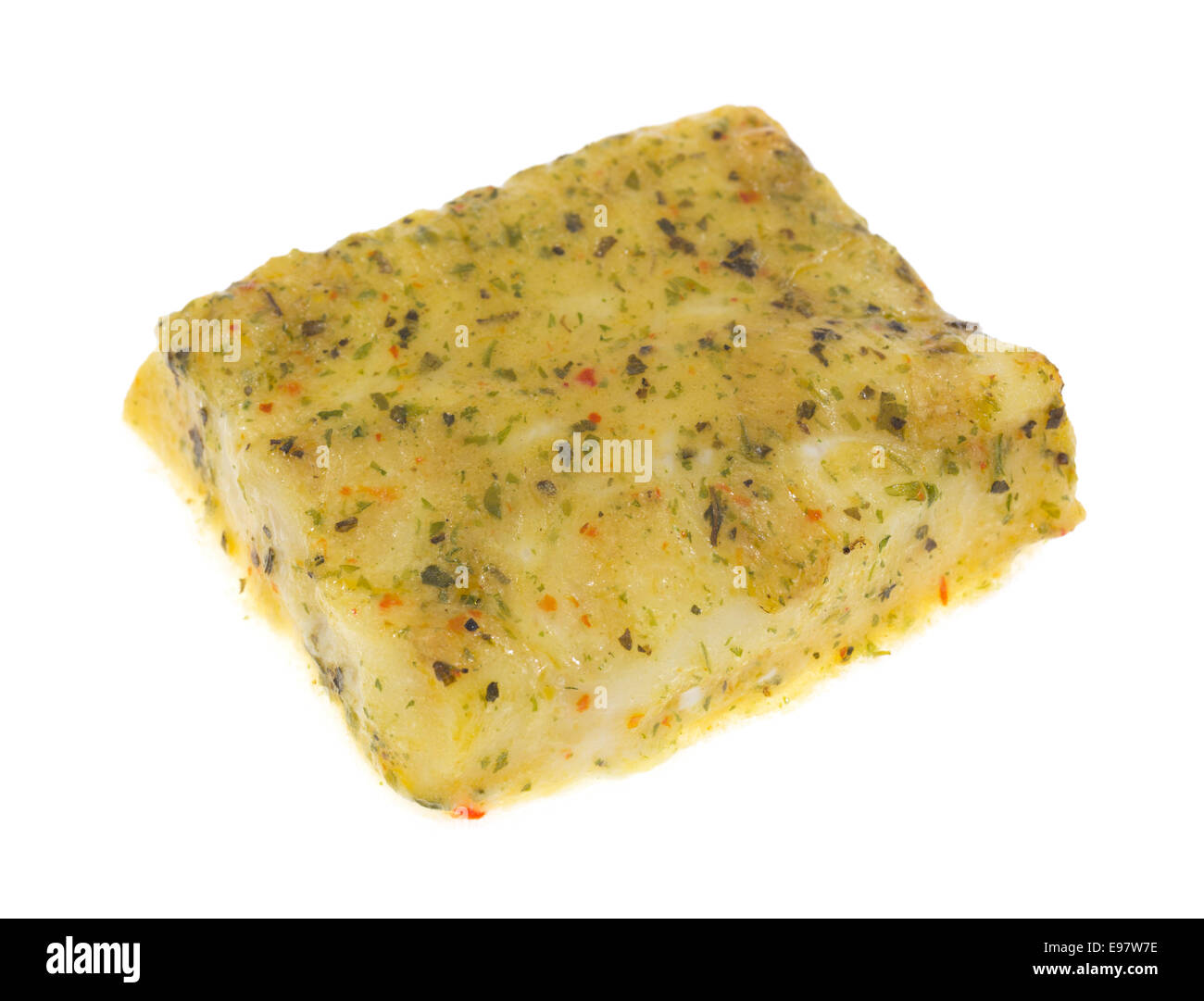 A fillet of pollack with herbs on a white background. - Stock Image