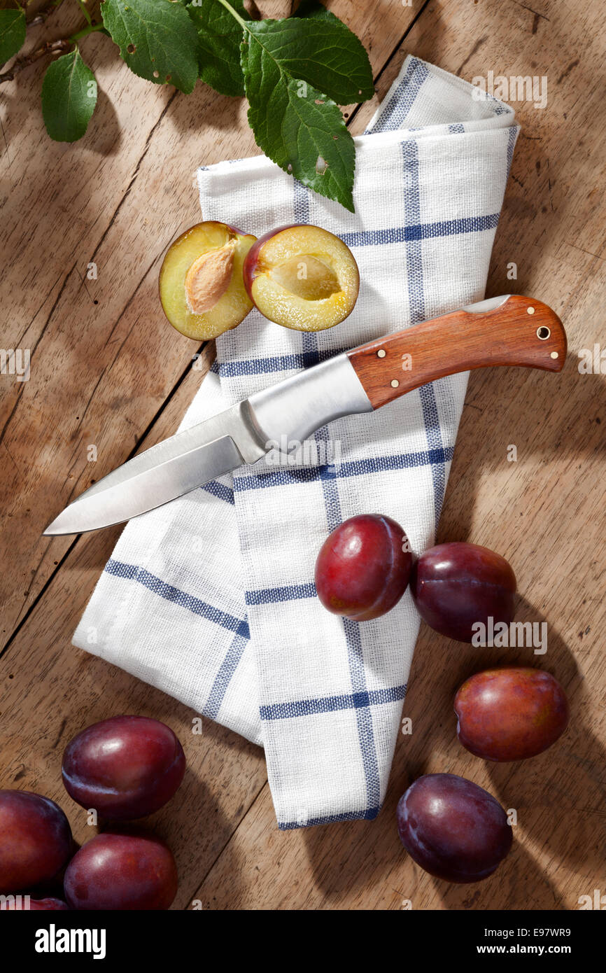 a pocket knife with plums - Stock Image